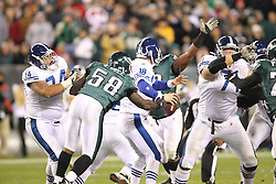 PHILADELPHIA - NOVEMBER 7: Trent Cole of the Philadelphia Eagles pressures Peyton Manning during a game against the Indianapolis Colts on November 7, 2011 at Lincoln Financial Field in Philadelphia, Pennsylvania.  (Photo by Hunter Martin/Getty Images) *** Local Caption ***