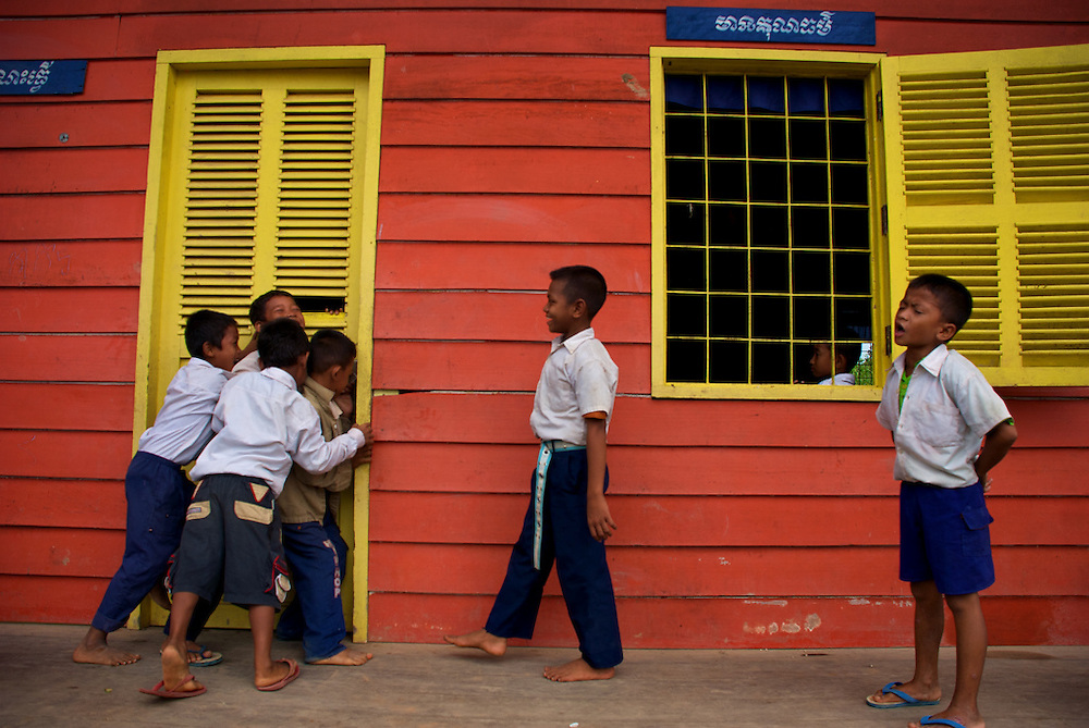 Students play outside their primary school classroom during recess in the floating village of Chong Kneas, just outside of Siem Reap, Cambodia.