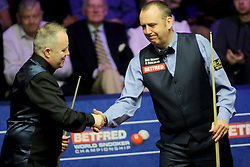 John Higgins (left) and Mark Wiliams shake hands during day seventeen of the 2018 Betfred World Championship at The Crucible, Sheffield.