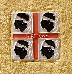 Detail of wall tile with emblem of Sardinia Island in Alghero Sardinian Italy