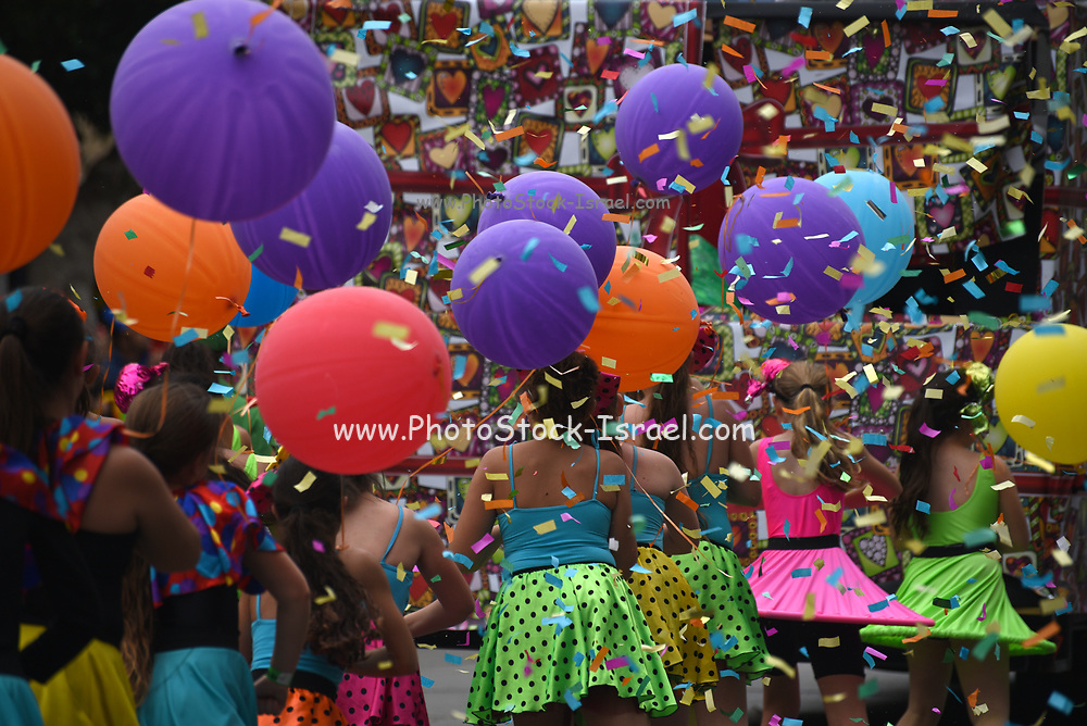 Ticker tape parade with colorful balloons