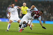 Jordan Ayew of Aston Villa ®  is tackled  by Danny Drinkwater (l) and Ngola Kante (c) of Leicester city. Barclays Premier league match, Aston Villa v Leicester city at Villa Park in Birmingham, The Midlands on Saturday 16th January 2016.<br /> pic by Andrew Orchard, Andrew Orchard sports photography.