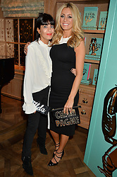 Left to right, CLAUDIA WINKLEMAN and TESS DALY at a party hosted by Ewan Venters CEO of Fortnum & Mason to celebrate the launch of The Cook Book by Tom Parker Bowles held at Fortnum & Mason, 181 Piccadilly, London on 18th October 2016.