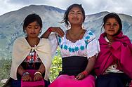 Three young women attending a Kapak Raymi celebration in Cotacachi, Ecuador