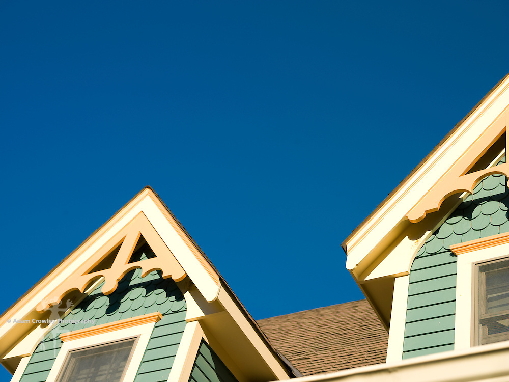 Victorian gabled windows and sky.