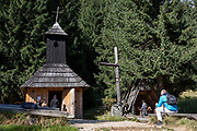 Pilgrims visit the small chapel of St. Jana Chrzciciela at the top of Polana Chocholowska a hiking route on Dolina Chocholowska in the Tatra National Park, on 17th September 2019, near Zakopane, Malopolska, Poland.