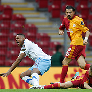 Galatasaray's Ayhan AKMAN (R) and Trabzonspor's Jakson Avelino COELHO (L) during their Turkish superleague soccer derby match Galatasaray between Trabzonspor at the TT Arena in Istanbul Turkey on Sunday, 10 April 2011. Photo by TURKPIX