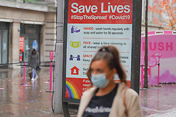 © Licensed to London News Pictures 28/10/2020. Nottingham  , UK. A shopper wearing a  face mask walks  in the city centre before new restrictions come into force in Nottingham. The county of Nottinghamshire will enter into Tier 3 ,from 00:01 am on Friday 30 October. Photo credit: Ioannis Alexopoulos/LNP