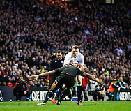 Picture by Andrew Tobin/SLIK images +44 7710 761829. 2nd December 2012. Chris Ashton of England is tackled during the QBE Internationals match between England and the New Zealand All Blacks at Twickenham Stadium, London, England. England won the game 38-21.
