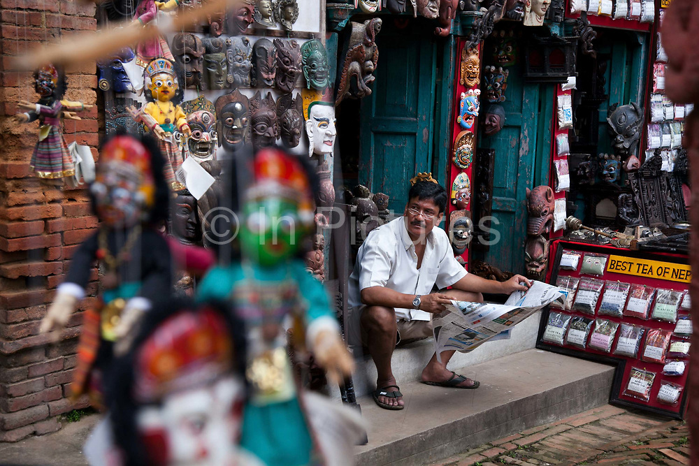 A shop keeper is waiting for customers in Bhaktapur. Summer is rainy season and not many tourists visit Nepal at this time of year.