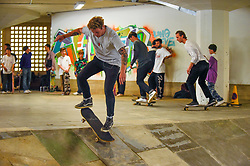 © Licensed to London News Pictures. 20/07/2019. LONDON, UK.  Keen skateboarders perform their moves at the Southbank Undercroft skate park which has re-opened today after a GBP1.1m facelift and extension.  Known as the 'home of British skateboarding', improved lighting, concrete banks and a 426m extension allows more people to use the free facility.  Photo credit: Stephen Chung/LNP
