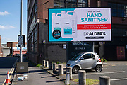 Hand sanitiser advertising boards in an inner city area virtually deserted under Coronavirus lockdown on 5th May 2020 in Birmingham, England, United Kingdom. Coronavirus or Covid-19 is a new respiratory illness that has not previously been seen in humans. While much or Europe has been placed into lockdown, the UK government has put in place more stringent rules as part of their long term strategy, and in particular social distancing.