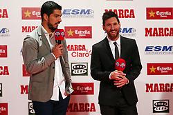 November 24, 2017 - Barcelona, Catalonia, Spain - Barcelona football player Luis Suarez (L) gives the Golden Boot award to Lionel Messi (L) at the Old Estrella Damn Factory on November 24, 2017 in Barcelona, Spain. (Credit Image: © Urbanandsport/NurPhoto via ZUMA Press)