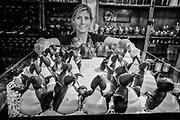 Waitress serves iced penguin cakes, Ramos Generales cafe, Ushuaia, Argentina.