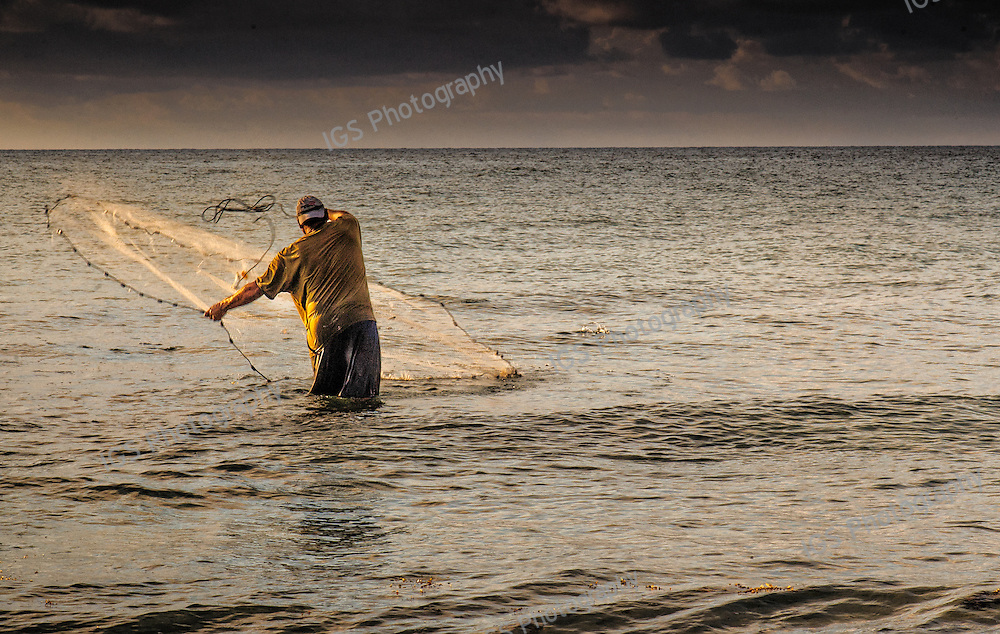 Cast Net Fishing at Sunrise of the beach in Boca Raton Florida