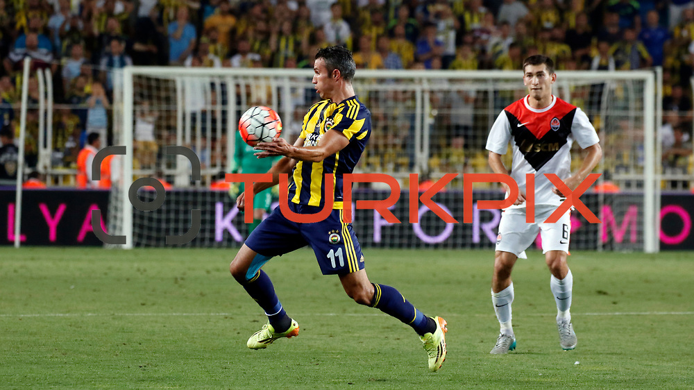 Fenerbahce's (L) Van Persie and Shakhtar Donetsk's (R) Stepanenko during their UEFA Champions league third qualifying round first leg soccer match Fenerbahce between Shakhtar Donetsk at the Sukru Saracaoglu stadium in Istanbul Turkey on Tuesday 28 July 2015. Photo by Aykut AKICI/TURKPIX