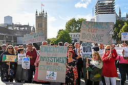 © Licensed to London News Pictures. 28/09/2018. LONDON, UK. Head teachers with a banners and placards join hundreds of other head teachers at a rally in Parliament Square to demand extra funding for schools ahead of a petition being delivered to Number 11 Downing Street.  With a reported reduction in per student funding in real terms since 2010, members of the National Union of Head Teachers and the Association of School and College Leaders attending the rally also warn of increasing class sizes, staff cuts, and reduced subject choice.  Photo credit: Stephen Chung/LNP