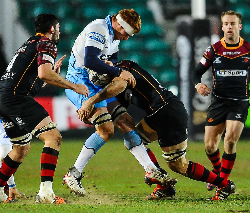 Glasgow Warriors' Rob Harley is tackled by Dragons' Nic Cudd<br /> <br /> Photographer Craig Thomas/CameraSport<br /> <br /> Rugby Union - Guinness PRO12 Round 16 - Newport Gwent Dragons v Glasgow Warriors - Thursday 25th February 2016 - Rodney Parade - Newport<br /> <br /> © CameraSport - 43 Linden Ave. Countesthorpe. Leicester. England. LE8 5PG - Tel: +44 (0) 116 277 4147 - admin@camerasport.com - www.camerasport.com