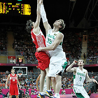 02 August 2012: Russia Alexey Shved goes for the floater against Brazil Tiago Splitter during 75-74 Team Russia victory over Team Brazil, during the men's basketball preliminary, at the Basketball Arena, in London, Great Britain.