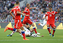Yusuf Yazici (C) of Turkey in action againstAleksandr Samedov (R) of Russia during the soccer friendly match between Russia and Turkey at VTB arena in Moscow, Russia, 05 June 2018. Photo by TFF - Depo Photos/ABACAPRESS.COM
