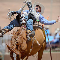 Bareback rider Delvecchio Kaye makes an 80-point ride during the Gallup Inter-tribal Indian Ceremonial rodeo Saturday at Red Rock Park.