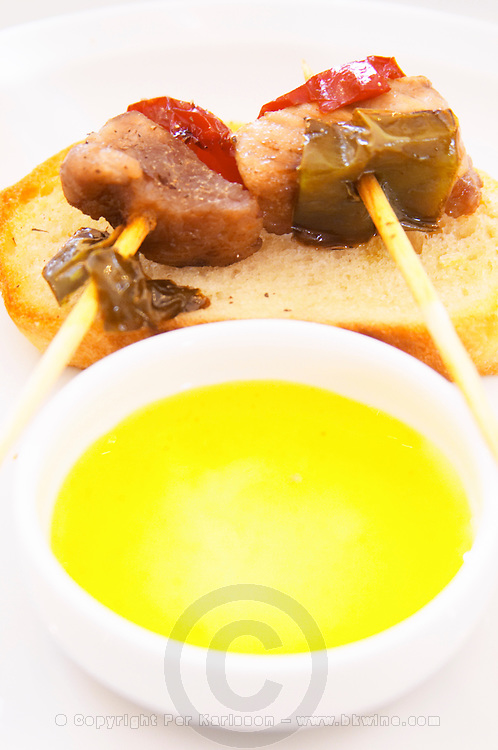 Grilled skewer pork on bread with light yellow sauce. Bodega Del Anelo Winery, also called Finca Roja, Anelo Region, Neuquen, Patagonia, Argentina, South America