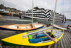 Lerwick, the main port of the Shetland Islands, Scotland, located more than 100 miles (160 km) off the north coast of mainland Scotland on the east coast of the Shetland Mainland