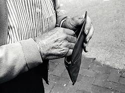 Elderly man shopping, Nottingham UK 1990