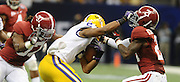 Daily Photo by Gary Cosby Jr.    ..Brad Lester and Dre Kirkpatrick tackle Rueben Randle for a loss during the second half of the BCS National Championship Game between Alabama and LSU in the Superdome Monday night...................................
