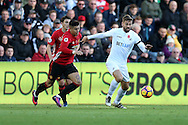Marcos Rojo of Manchester Utd (l) challenges Fernando Llorente of Swansea city.  .Premier league match, Swansea city v Manchester Utd at the Liberty Stadium in Swansea, South Wales on Sunday 6th November 2016.<br /> pic by  Andrew Orchard, Andrew Orchard sports photography.