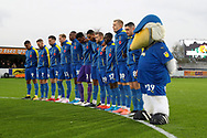 AFC Wimbledon players observing minutes silence during the The FA Cup match between AFC Wimbledon and Doncaster Rovers at the Cherry Red Records Stadium, Kingston, England on 9 November 2019.