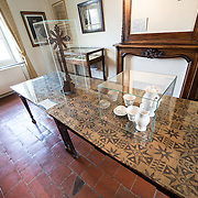 The dining room at the farmhouse known as Ferme du Caillou. Next to the field where the Battle of Waterloo took place in 1815, the farmhouse is famous as the place where Napoleon spent the night before the battle. It is now a museum. It was in this room that Napoleon ate his breakfast on the morning of the battle. On the three tables joined together in the center of the room, he laid out maps of the battlefield and passed on his battle orders to his General Staff crowded into the room.