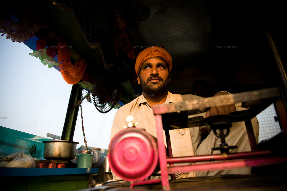 Cooking arrangement inside the truck,next to driver seat.