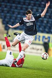 Hamilton's Grant Gillespie tackles Falkirk's Conor McGrandles.<br /> Falkirk 0 v 0 Hamilton, Scottish Championship game at The Falkirk Stadium. © Michael Schofield 2014.