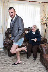 © Licensed to London News Pictures . Wythenshawe , Manchester , UK . FILE PICTURE DATED 23/03/2015 of Wayne Phillips (l) ( 40 , from Wythenshawe ) ( pictured with his mother Pat Banhan (68) ) . Phillips , who is currently (20th November 2015) working as a self-employed DPD delivery driver , became famous after pranking TV adverts and performing gags and stunts on YouTube and Vine , including a spoof of the Money Supermarket advert which he acted out in high heels and short shorts , near to his home , at Wythenshawe Precinct , in South Manchester and which went viral . Photo credit : Joel Goodman/LNP