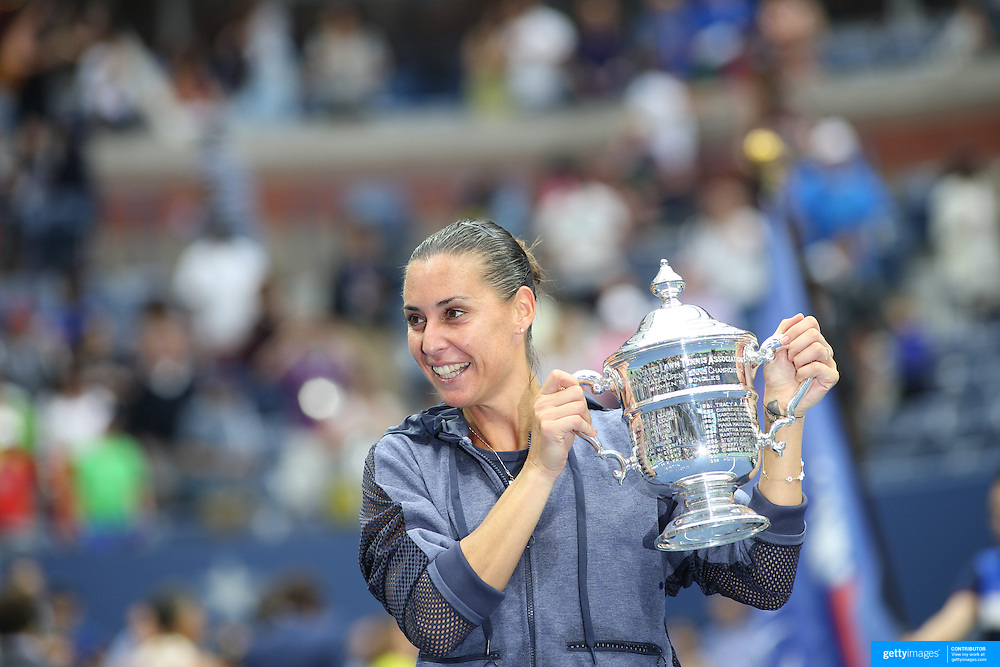Flavia Pennetta, Italy, celebrates with the trophy after her victory against Roberta Vinci, Italy, in the Women's Singles Final match during the US Open Tennis Tournament, Flushing, New York, USA. 12th September 2015. Photo Tim Clayton