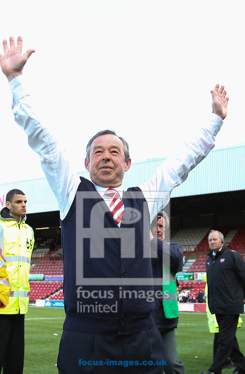 Picture by David Horn/Focus Images Ltd +44 7545 970036.27/04/2013.Brian Flynn , Manager of Doncaster Rovers celebrates with fans during the npower League 1 match at Griffin Park, London.