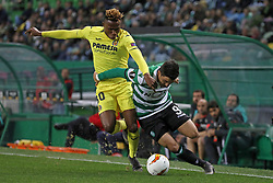 February 14, 2019 - Lisbon, Portugal - Samuel Chukwueze of Villarreal FC (L) vies for the ball with Marcos Acuña of Sporting CP (R) during the Europa League 2018/2019 footballl match between Sporting CP vs Villarreal FC. (Credit Image: © David Martins/SOPA Images via ZUMA Wire)