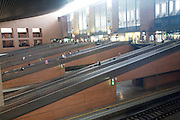 People on escalators inside Santa Justa railway station Seville, Spain