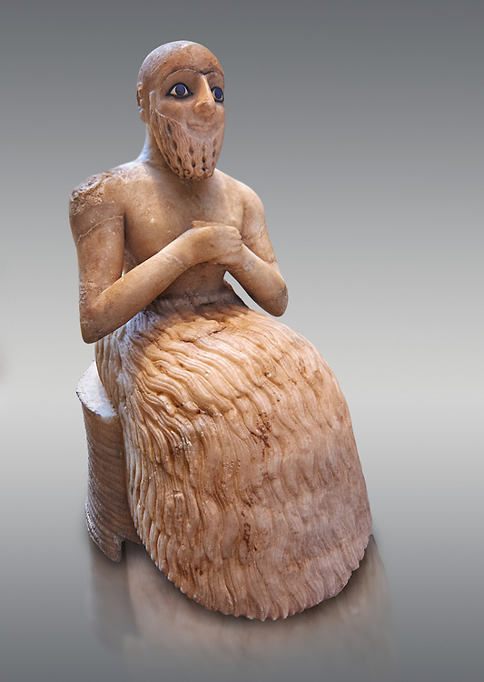 Gypsum, schist, shells and lapis lazuli statue of Ebih-Il, early Dynastic; Shakkanakku (military governor) of the ancient city-state of Mari in present day eastern Syria, dating from circa 2340 BC or from the Akkadian period of rule Circa 2250 BC.. The statue carries a cuneiform inscription in Akkadian. Excavated from; the temple of Ishtar at Mari by André Parrot in 1934-1935 the statue measures; 52.5 cm (20.7 in) high; 20.6 cm (8.1 in) wide and 30 cm (11.8 in) deep. Department of Oriental Antiquities; Richelieu; ground floor; room 1b; inv AO 17551; Louvre Museum; Paris .<br /> <br /> If you prefer to buy from our ALAMY PHOTO LIBRARY  Collection visit : https://www.alamy.com/portfolio/paul-williams-funkystock  Type -    Louvre Mari   - into the LOWER SEARCH WITHIN GALLERY box <br /> <br /> Visit our ANCIENT WORLD PHOTO COLLECTIONS for more photos to download or buy as wall art prints https://funkystock.photoshelter.com/gallery-collection/Ancient-World-Art-Antiquities-Historic-Sites-Pictures-Images-of/C00006u26yqSkDOM