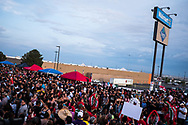 """People gather at a makeshift memorial for the victims of the Aug. 3 mass shooting in El Paso, Texas, Wednesday, August 7, 2019.<br /> <br /> The Cielo Vista Walmart is one of the busiest Walmart locations in the country and is also often referred to as the """"Juárez Walmart"""" because of its heavy cross-border customer traffic. There was up to 3,000 people at the store during the back-to-school shopping season at the time of the shooting, police said."""