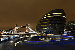 © Licensed to London News Pictures. 19/03/2016. London, UK. Tower Bridge and City Hall in London seen with the lights turned on shortly before the start of Earth Hour 2016. Landmarks around the world are switching their lights off for Earth Hour this evening, a global switch-off event aimed at protecting the planet and highlighting the effects of climate change. This year marks the 10th annual Earth Hour. Photo credit : Vickie Flores/LNP