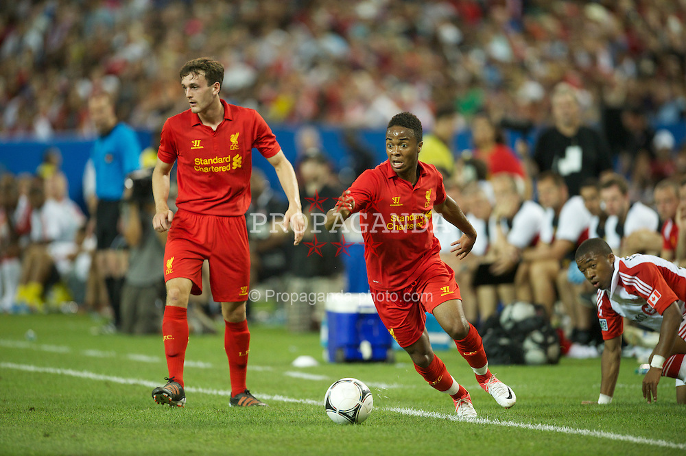 TORONTO, CANADA - Saturday, July 21, 2012: Liverpool's Jack Robinson and Raheem Sterling in action against Toronto during the first match of the North American pre-season tour at the Rogers Centre. (Pic by David Rawcliffe/Propaganda)