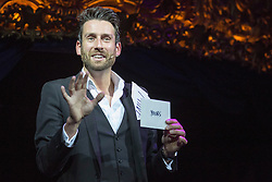 © Licensed to London News Pictures. 03/09/2015. London, UK. Jamie Raven, Britain's Got Talent, performs on stage. Press preview of the new magic show The Illusionists at Café de Paris, London. The touring magic show will open at London's Shaftesbury Theatre on 14 November 2015. Photo credit : Bettina Strenske/LNP