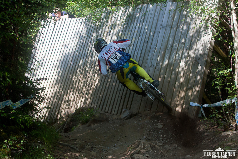 Evan Turpen (USA) takes the wall during the qualifying round of the mens downhill at the UCI Mountain Bike World Cup in Fort William, Scotland.