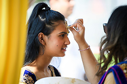 © Licensed to London News Pictures. 02/09/2018. Aldenham, UK. A young woman has the Tilaka stamp on her forehead as she arrives for the Janmashtami Hindu festival at Bhaktivedanta Manor Temple in Aldenham, Hertfordshire. Janmashtami is an annual Hindu festival that celebrates the birth of Krishna. Bhaktivedanta Manor, the venue fo the event, was donated to the Hare Krishna movement in February 1973 by former Beatle George Harrison. Photo credit: Ben Cawthra/LNP