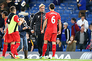 Jurgen Klopp, the Liverpool manager celebrates after the final whistle with Dejan Lovren of Liverpool. Premier league match, Chelsea v Liverpool at Stamford Bridge in London on Friday 16th September 2016.<br /> pic by John Patrick Fletcher, Andrew Orchard sports photography.