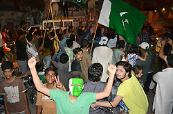 June 18, 2017 - Hyderabad, Sindh, Pakistan - Pakistani youngsters holding Pakistani flag and performing dance after the wining of final match between Pakistan and India in champions trophy on June 18. (Credit Image: © Janali Laghari/Pacific Press via ZUMA Wire)