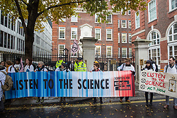 London, UK. 22 November, 2019. Climate activists from Scientists for XR gather outside the headquarters of the Conservative Party during a demonstration intended to communicate the science relating to the climate and ecological emergency. Activists were dressed in labcoats to represent the 1600 scientists worldwide who have signed the Scientists Declaration in support of non-violent direct action against government inaction against the climate and ecological emergency.