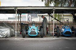 © Licensed to London News Pictures. <br /> 13/09/2019.  <br /> Goodwood.West, Sussex. UK.<br /> The Goodwood Motor Circuit celebrates the 21st year of the Revival.This has become one of the biggest annual historic motorsport events in the world and the only one to be staged entirely in period dress. Each year over 150,000 people descend on this quiet corner of West Sussex to enjoy the three-day event.<br /> Pictured An enthusiast admires a Talbot Lago 26c<br /> <br /> Photo credit: Ian Whittaker/LNP